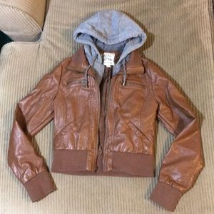 Brown leather jacket with gray sweatshirt hood